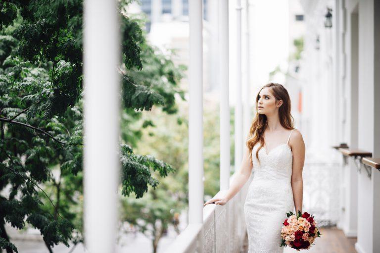 wedding bride on balcony with city views